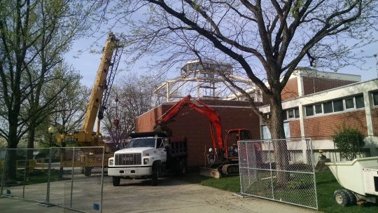 1. Green house being moved off building